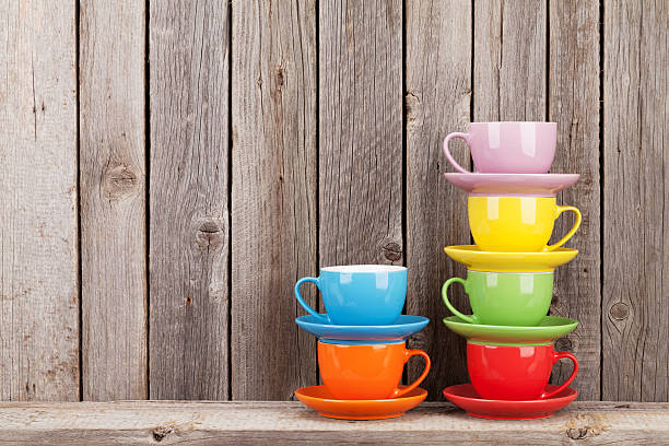 Colorful coffee cups on shelf stock photo