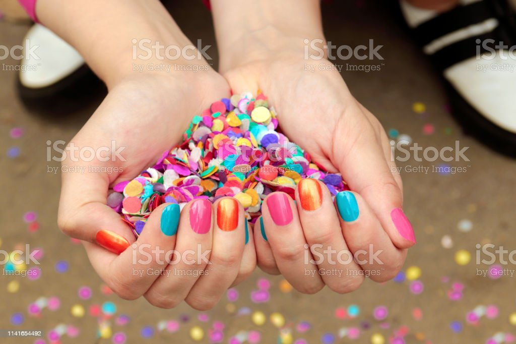 Colorful colorful manicure with confetti Colorful colorful manicure with confetti.Nail design. Acrylic Painting Stock Photo