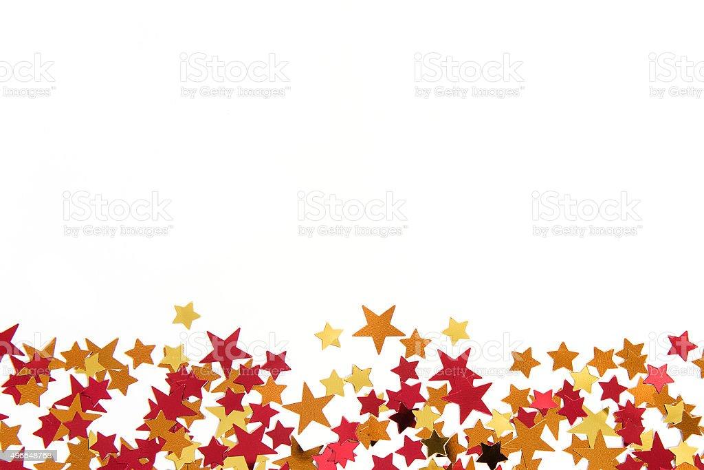 colorful confetti background. gold, red, yellow, orange stock photo