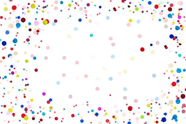 colorful confetti in front on isolated white background - anniversary stock photos and pictures