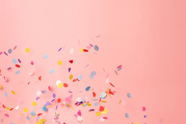 Colorful confetti on pastel pink background. Bright and festive holiday background. Colorful confetti on pink background. Copyspace for text. Bright and festive holiday background. For Mother's day and birthday cellebration carnival celebration event stock pictures, royalty-free photos & images