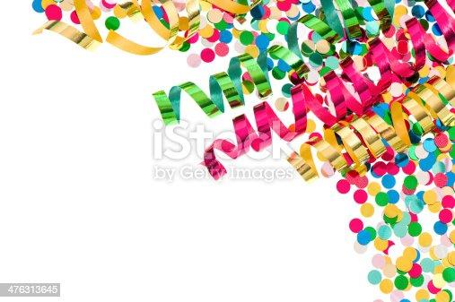 istock colorful confetti with multicolored streamer 476313645