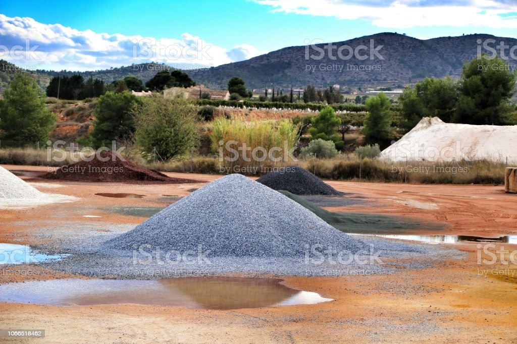 Colorful construction aggregate mountains in Spain stock photo