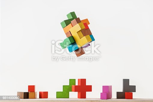 istock Colorful constructor, logic game, cubic mosaic. Design created by cubes. The concept of logical thinking, geometric shapes. 931400090