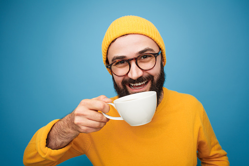 Colorful content man drinking coffee