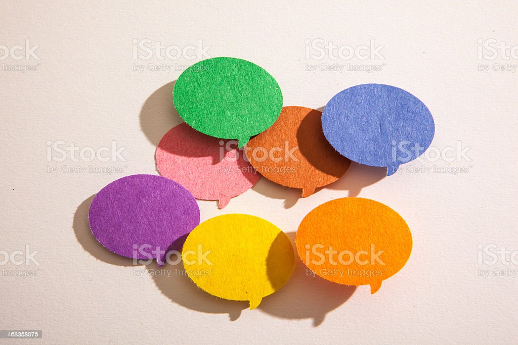 Colorful conversation bubbles on an off white background. royalty-free stock photo