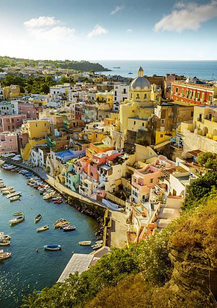 colorful corricella village on procida island in italy - procida foto e immagini stock
