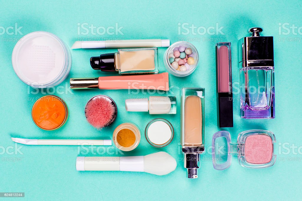 Colorful cosmetics on blue workplace stock photo