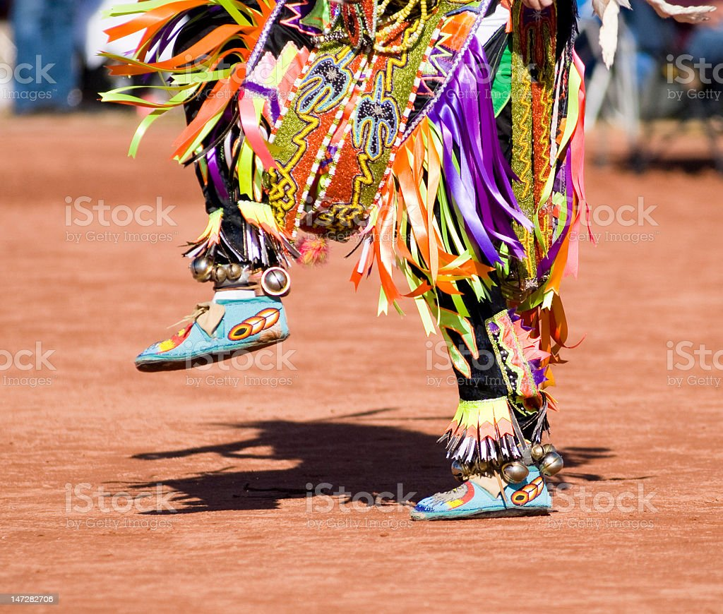 Colorful costume on the lower half of a pow wow dancer stock photo