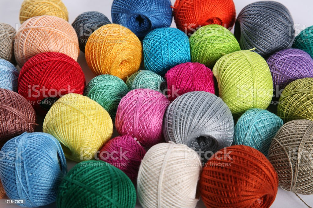 Colorful cotton yarn clews on gray table royalty-free stock photo
