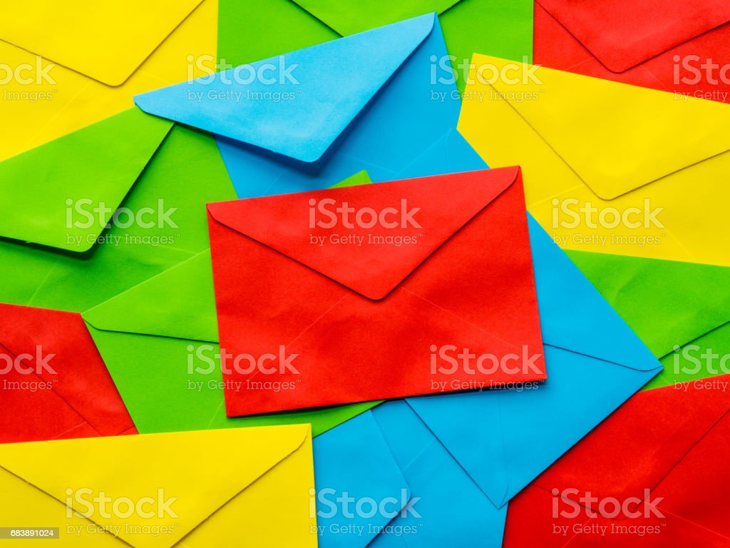 colorful cover letter background. Multi colored envelopes and letters...