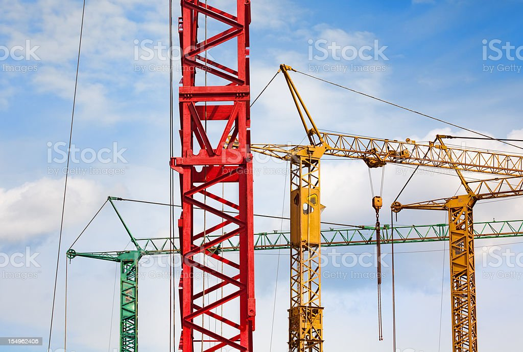 Colorful cranes against blue sky royalty-free stock photo