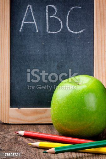 istock Colorful crayons and apple 178628721