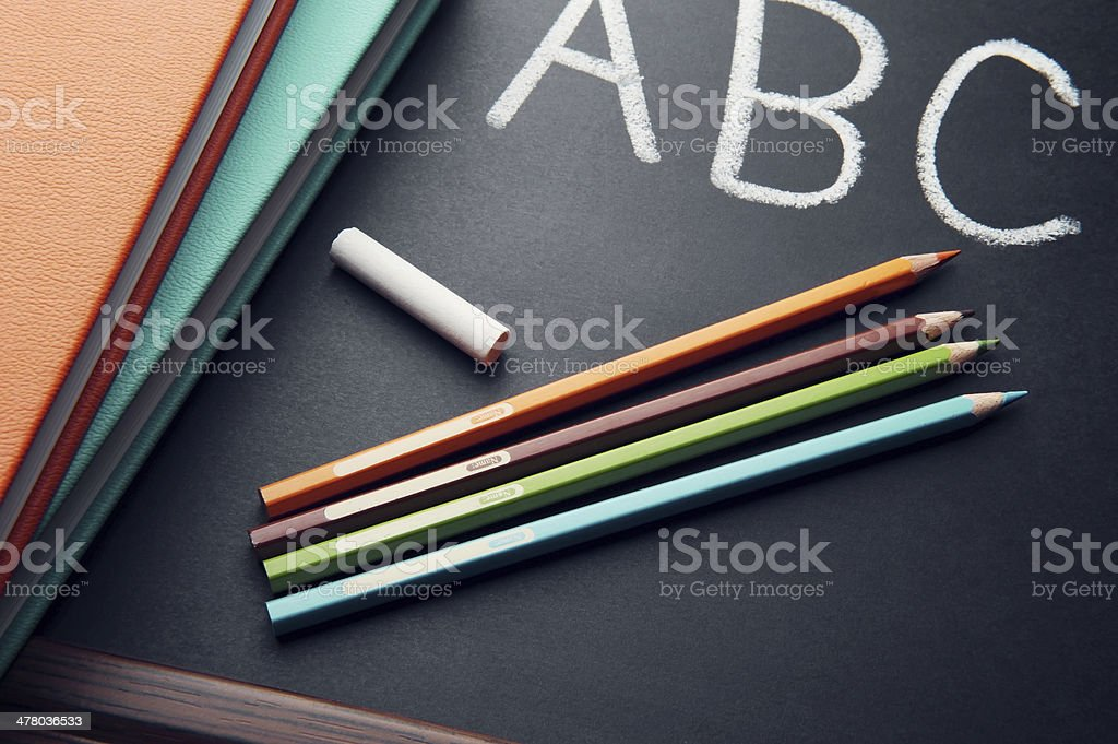 Colorful crayons and chalkboard royalty-free stock photo