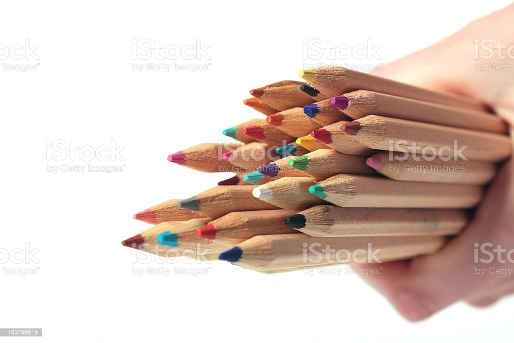 Colorful crayons holding in hand stock photo