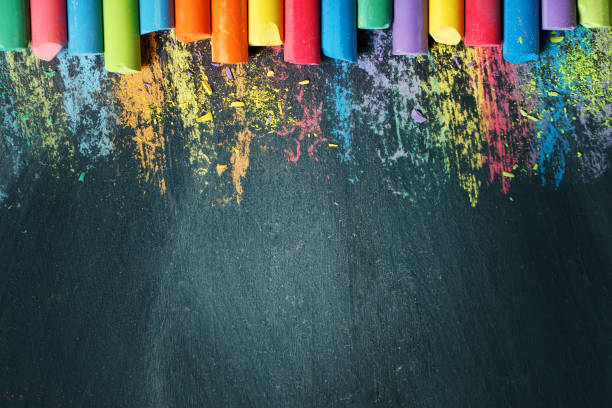 Colorful crayons on the blackboard, drawing. Back to school background Colorful crayons on the blackboard, drawing. Back to school background. Selective focus. Background with copy space. chalk art equipment stock pictures, royalty-free photos & images