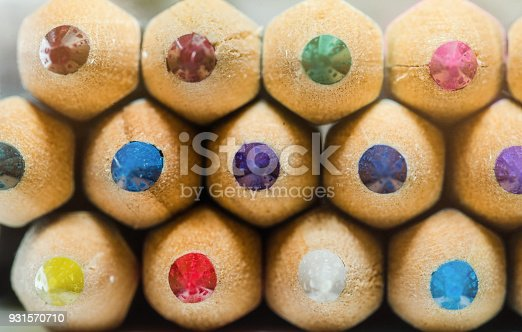 colorful crayons on white background with a shallow depth of field for effect