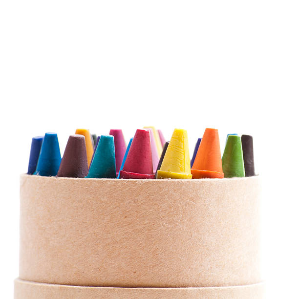 Colorful crayons organized in a cardboard box stock photo