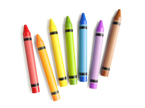 Colorful crayons scattered on white background. Horizontal composition with copy space.