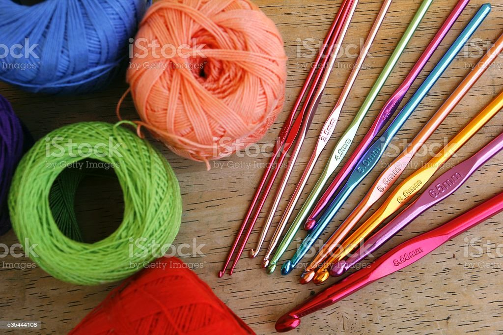 Colorful crochet hooks and granny squares stock photo