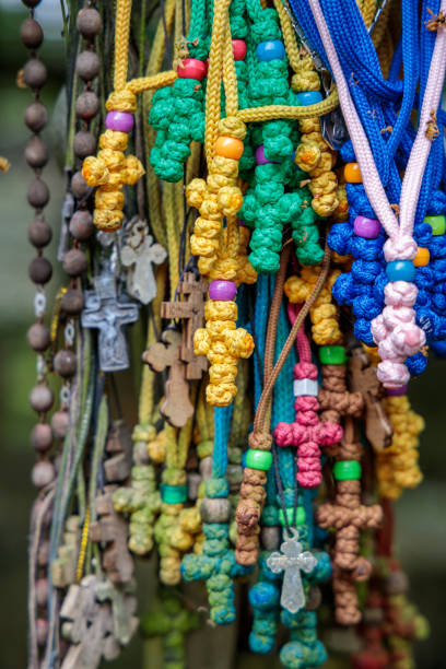 colorful crosses made of thread on the Holy Mountain of Grabarka in Poland stock photo