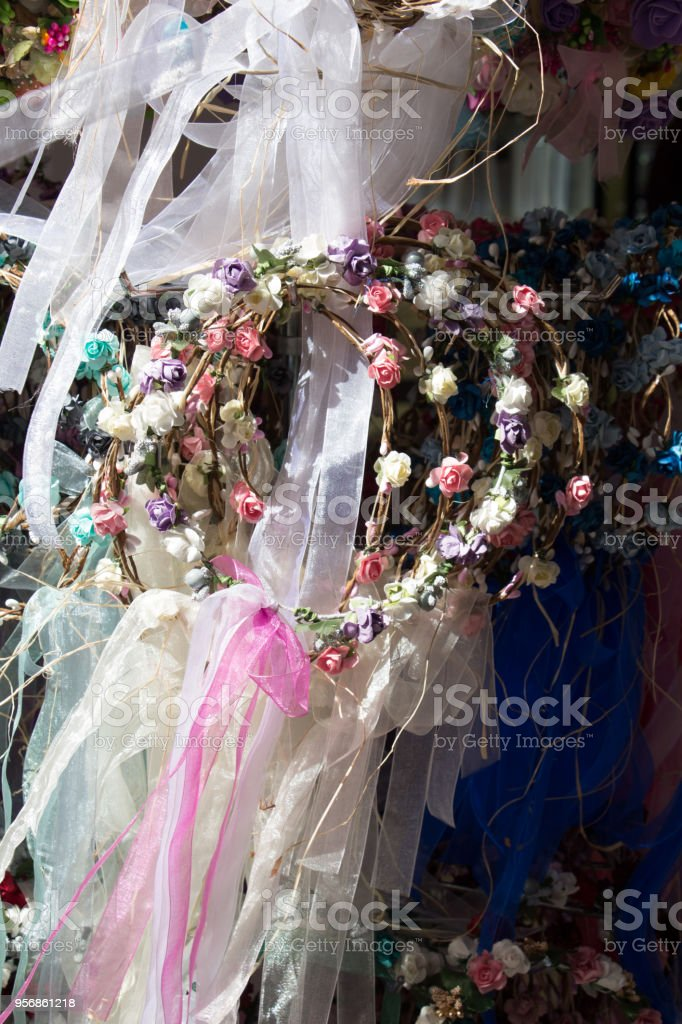 colorful crowns made of fake flowers stock photo