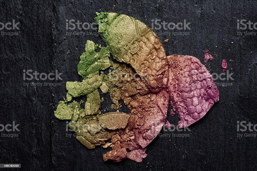 Colorful Crushed Eye Shadow on Blackboard stock photo