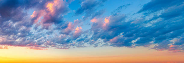 Colorful Cumulus Humilis Clouds at Sunset stock photo