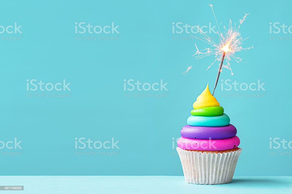 Colorful cupcake with sparkler stock photo