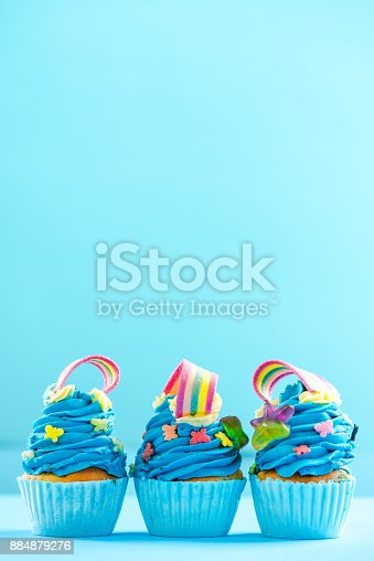653645234 istock photo Colorful cupcakes, celebration or birthday card mockup 884879276