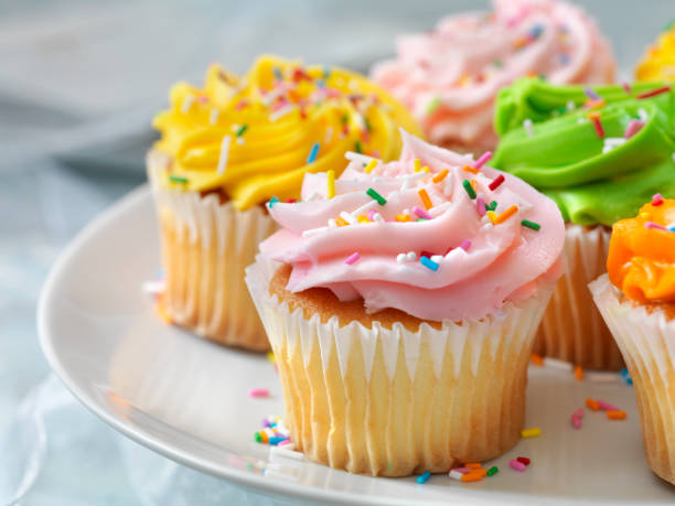 Colorful Cupcakes with Candy Sprinkles stock photo