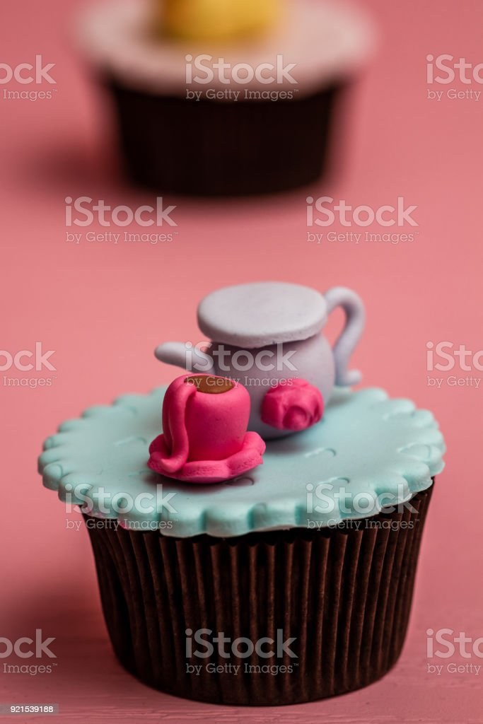 Colorful Cupcakes with Cute Figures stock photo