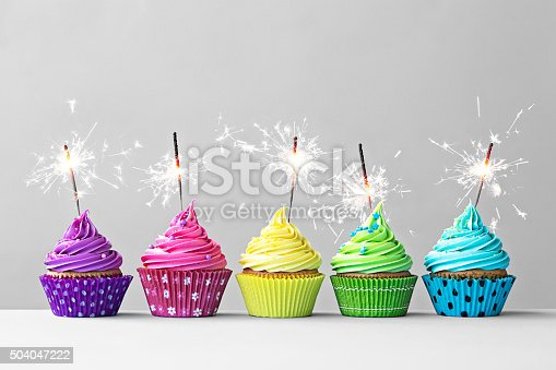 istock Colorful cupcakes with sparklers 504047222