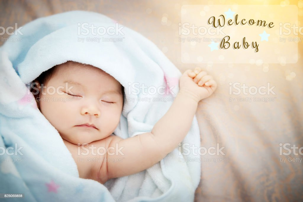 Colorful cute baby shower beautiful card with text welcome new baby in transparent frame, with the gold elements , star and wonderful bokeh in the morning light. film effect stock photo