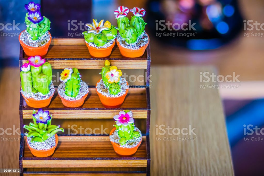 Colorful cute ceramic cactus in pot for sale at the tree market. royalty-free stock photo