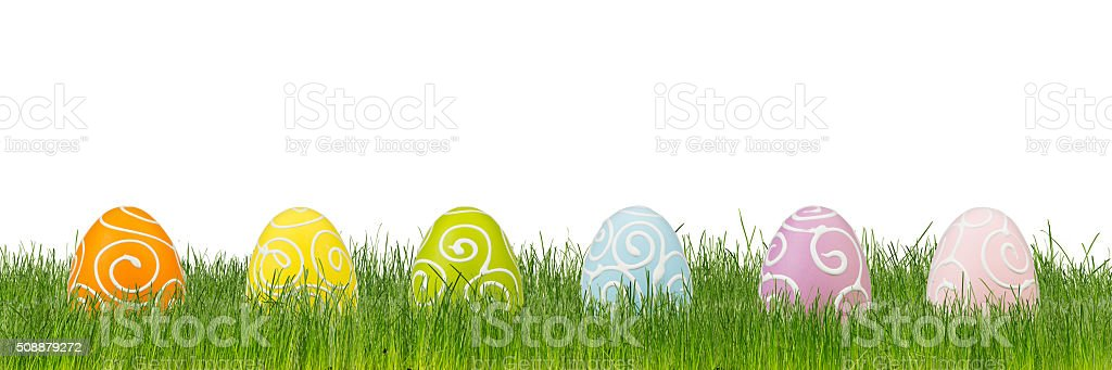colorful decorated easter eggs on green grass stock photo