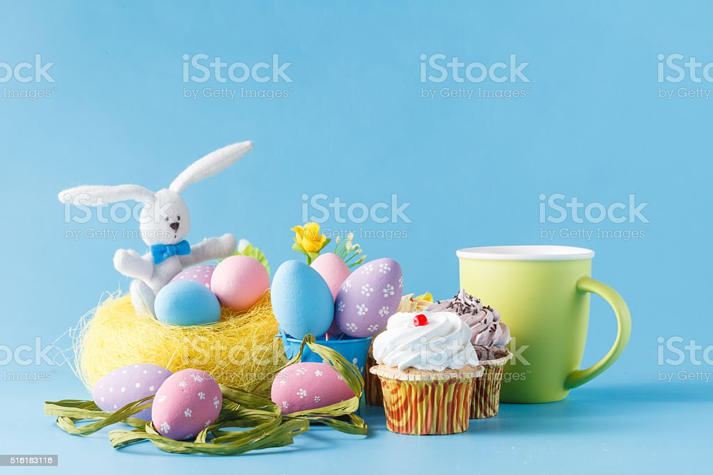 Colorful decoration of kids birthday party table with easer eggs stock photo
