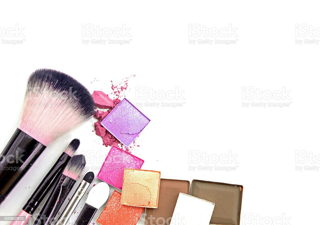 Colorful Decorative cosmetics on white concrete floor workplace. Top view stock photo
