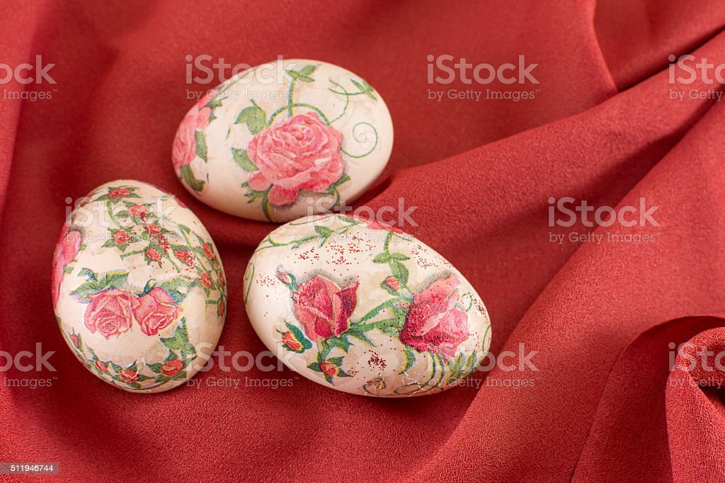 Colorful decoupage decorated Easter eggs on red stock photo