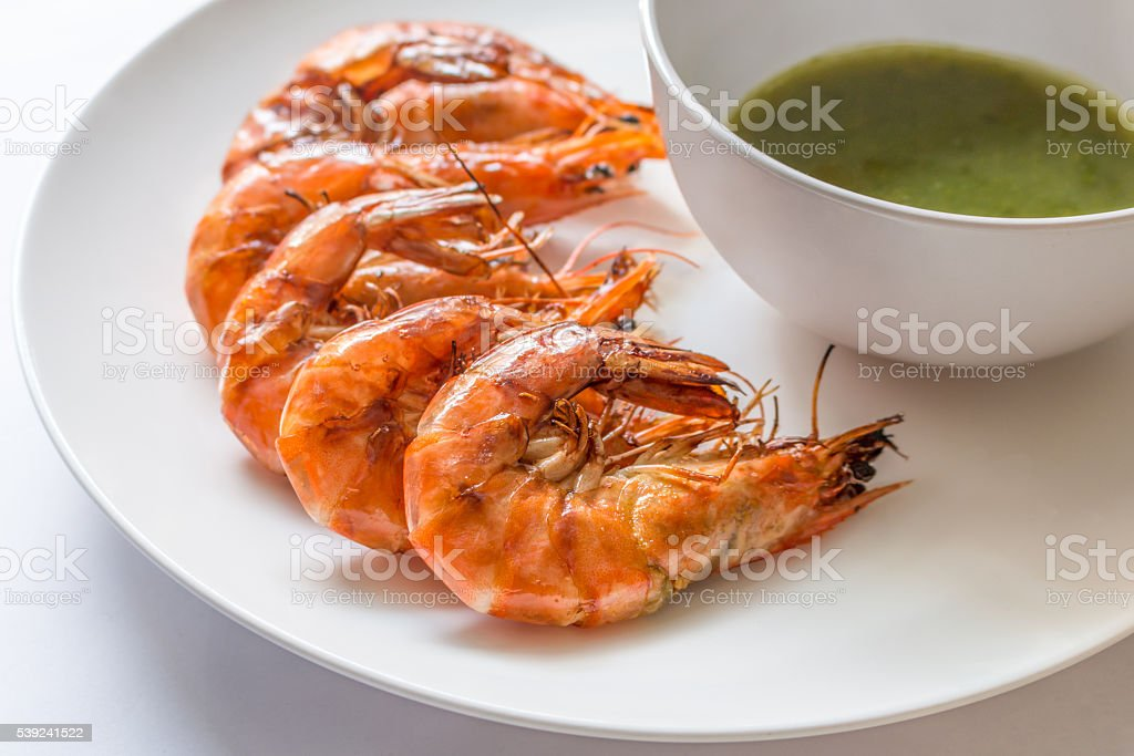 Colorful delicious grilled shrimp with spicy seafood sauce,  Clo stock photo