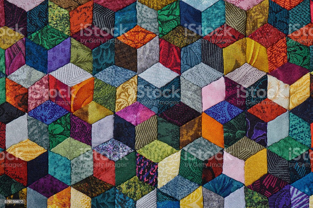 Colorful detail of quilt sewn from diamond pieces stock photo