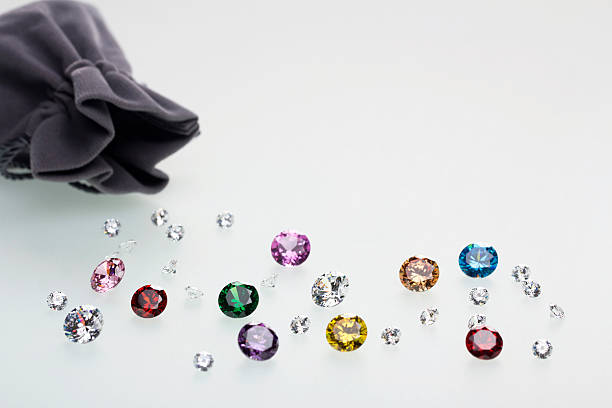 Colorful diamonds out of a bag stock photo