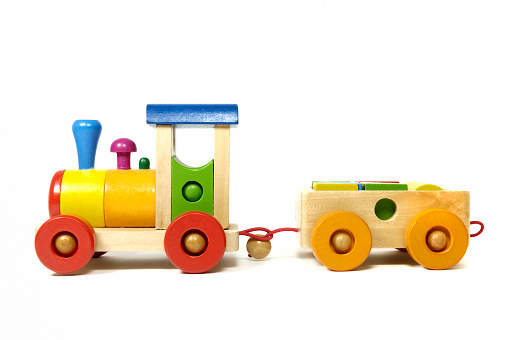 Multi-colored wooden toy train in front of a white background. Toy has no copyright protection!