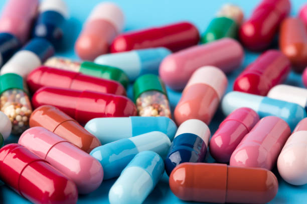 Colorful different medicine capsules stock photo