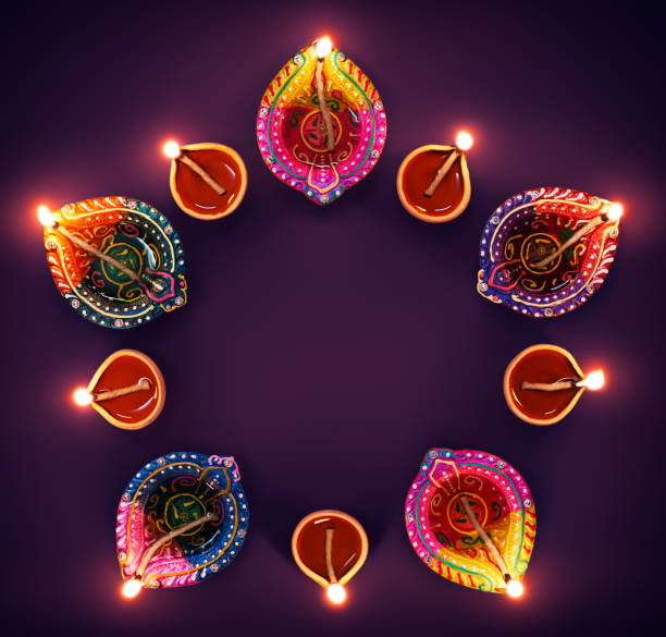 colorful diya lamps in a circle formation - diwali stock pictures, royalty-free photos & images