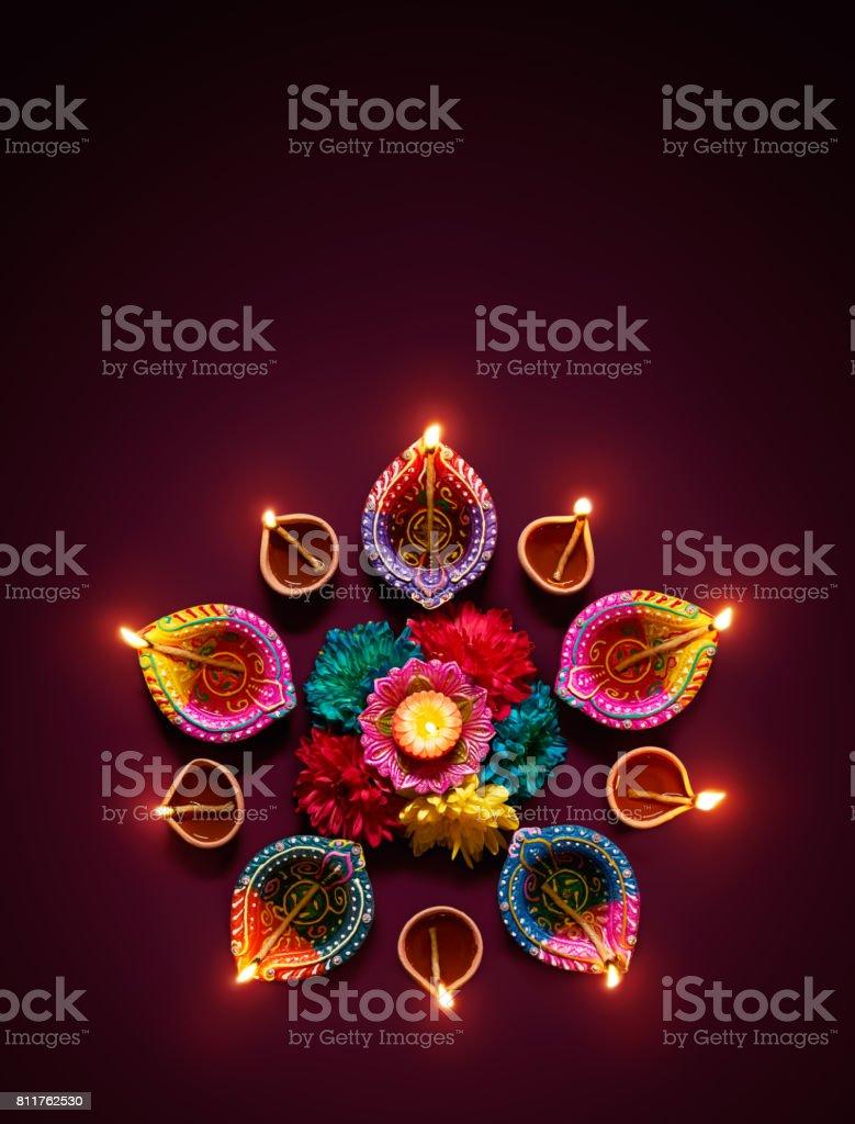 Colorful diya lamps lit during diwali celebration stock photo