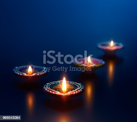 istock Colorful diya lamps lit during diwali celebration 969343084