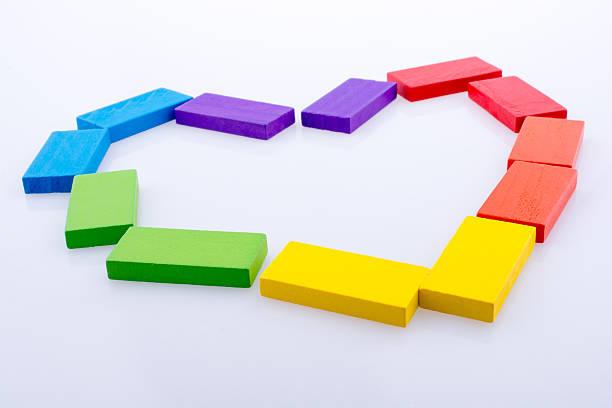 colorful domino blocks form a heart - honig wirkung stock-fotos und bilder