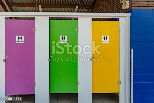 487881729 istock photo Colorful door of toilet at Airlie Beach in the tropical Whitsundays, Australia. 1205811711