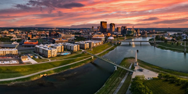 Colorful Downtown Sunset A panoramic aerial drone view over the confluence of the Great Miami and Mad Rivers looking toward downtown Dayton, Ohio under a colorful pink sunset. ohio stock pictures, royalty-free photos & images